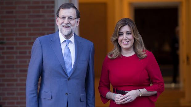 El presidente del Gobierno y del PP, Mariano Rajoy, junto a la presidenta andaluza Susana Díaz